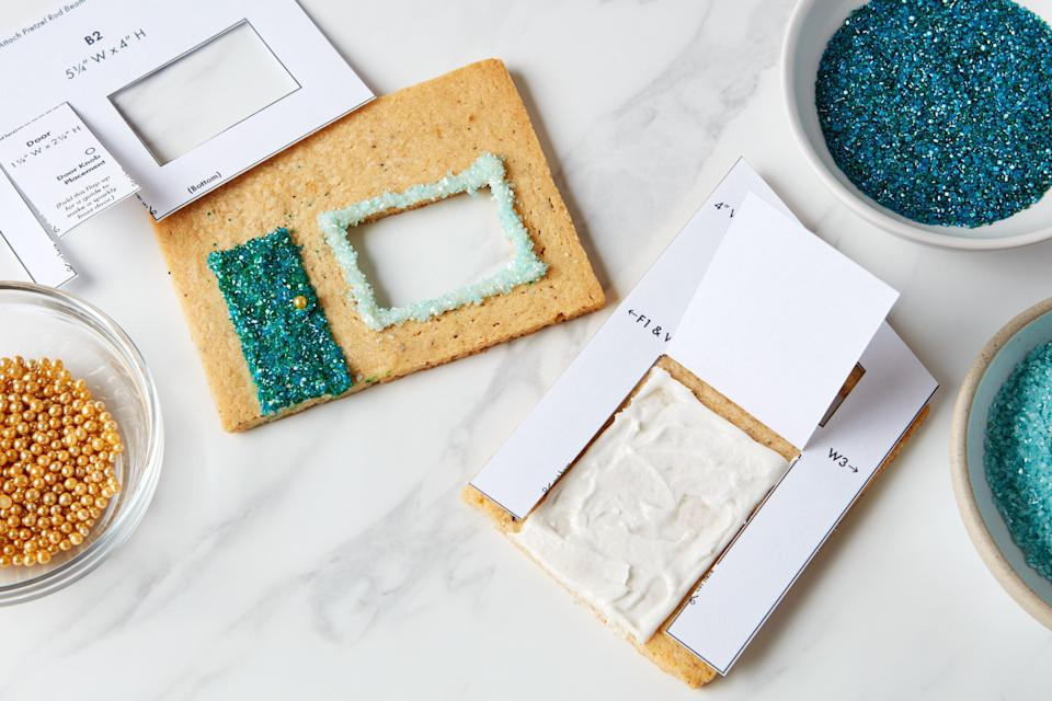 Photo M: On the printed template, each door (on F2 and B2) has a paper flap that's designed to fold up. This flap will reveal the door area, which you'll decorate in a festive shade of teal. Decadent doors deserve gold dragée door knobs. Define the front double-door entrance further with a contrasting light blue chunky sugar—you can see the finished look in Photo N below.