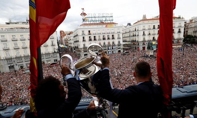 Soccer Football - Real Madrid celebrate winning the Champions League Final - Madrid, Spain - May 27, 2018 Real Madrid's Marcelo and Sergio Ramos celebrate with the Champions League trophy during a ceremony REUTERS/Javier Barbancho