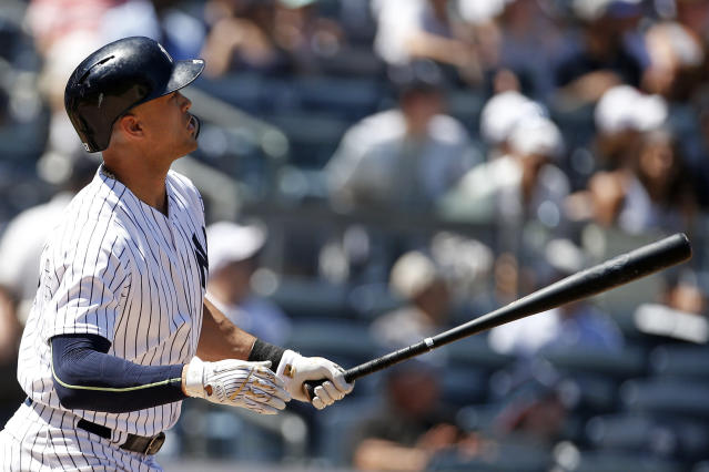 New York Yankees' Giancarlo Stanton watches his solo home run during the fifth inning of a baseball game against the Tampa Bay Rays on Saturday, June 16, 2018, in New York. (AP Photo/Adam Hunger)