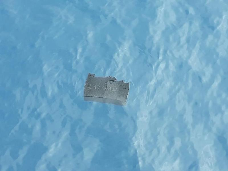 A piece of foam is seen floating near the area where the plane disappeared on the way to Antarctica. Source: AAP