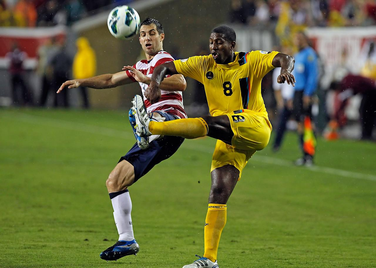 TAMPA, FL - JUNE 08:  Defender Carlos Bocanegra #3 of Team USA battles midfielder Mikele Leigertwood #8 of Team Antigua and Barbuda for the ball during the FIFA World Cup Qualifier Match at Raymond James Stadium on June 8, 2012 in Tampa, Florida.  (Photo by J. Meric/Getty Images)
