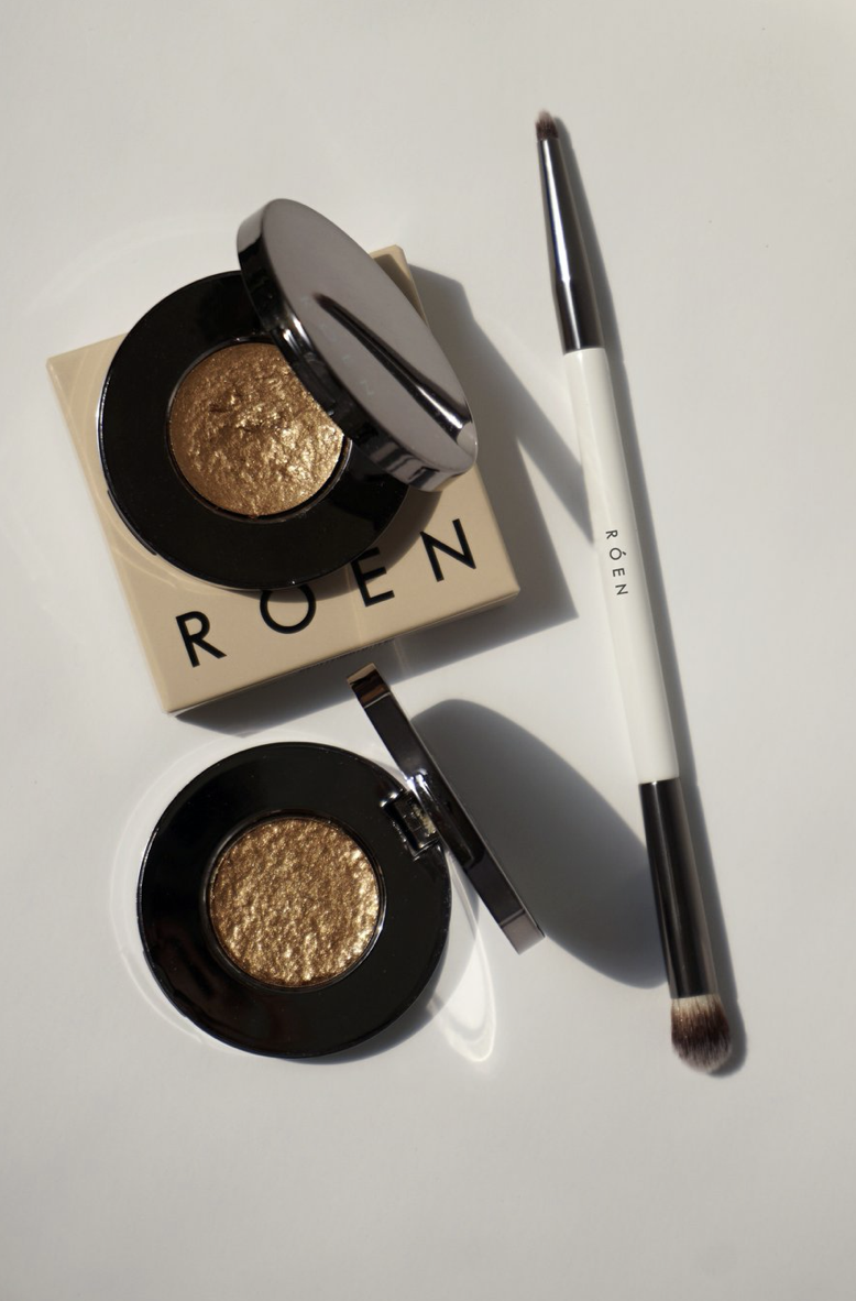 """<p><strong>Roen Beauty </strong></p><p>roenbeauty.com</p><p><strong>$29.00</strong></p><p><a href=""""https://www.roenbeauty.com/products/summer-disco"""" rel=""""nofollow noopener"""" target=""""_blank"""" data-ylk=""""slk:Shop Now"""" class=""""link rapid-noclick-resp"""">Shop Now</a></p><p>""""I have never been an eyeshadow person, but I'm suddenly feeling excited about the prospect of sporting sparkly, party-ready lids. I love Roen Beauty's Summer Disco—a golden shade with sustainably sourced mica particles that imparts instant Studio 54-era glamour."""" <em>—April Long, Beauty Director</em></p>"""