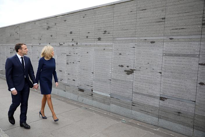 France's President Emmanuel Macron and first lady Brigitte Macron visit the Remembrance Park, a monument on the banks of the Rio de la Plata in memory of the 30,000 people who disappeared or were killed under the 1976-1983 military regime, in Buenos Aires Thursday. (Photo: Ludovic Marin/AFP/Getty Images)