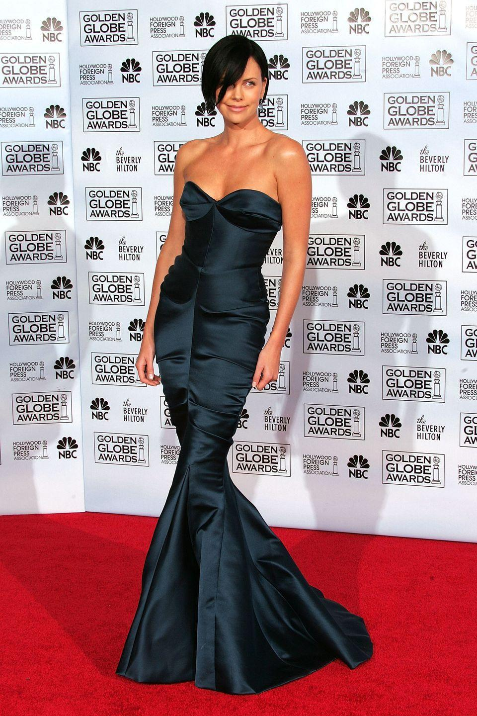 <p>The South African actress cut a perfect figure in Dior in 2005.</p>