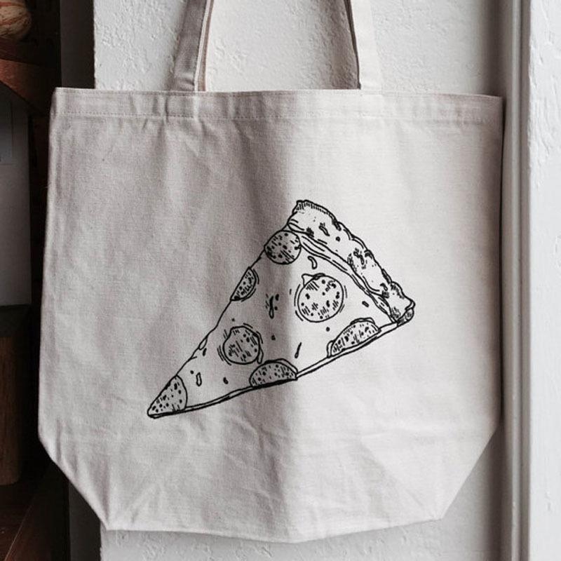 """<p>For the pizza fiend on your list, you can't go wrong with this canvas tote bearing a hand-drawn illustration of the perfect pepperoni slice. Created by Delancey, the beloved Seattle pizzeria, this sturdy tote also features the restaurant's logo. Take it to the farmer's market, and don't forget the tomatoes and mozzarella! <b>Price: $17. <a href=""""https://www.etsy.com/listing/256817247/delancey-pizza-tote?ga_order=most_relevant&ga_search_type=all&ga_view_type=gallery&ga_search_query=delancey%20pizza%20tote&ref=sr_gallery_1"""" rel=""""nofollow noopener"""" target=""""_blank"""" data-ylk=""""slk:Find the pizza tote at Delancey's Etsy shop"""" class=""""link rapid-noclick-resp"""">Find the pizza tote at Delancey's Etsy shop</a>. </b><i>(Photo: <a href=""""https://www.etsy.com/shop/DelanceySeattle?ref=l2-shopheader-name"""" rel=""""nofollow noopener"""" target=""""_blank"""" data-ylk=""""slk:DelanceySeattle"""" class=""""link rapid-noclick-resp"""">DelanceySeattle</a>/Etsy)</i></p>"""