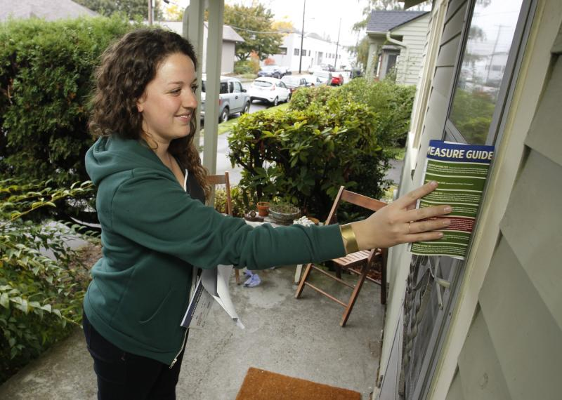 Canvasser leaves campaign literature to drum up support for Oregon's Measure 91, which would legalize the recreational use of marijuana in Portland, Oregon