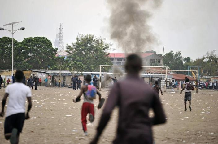 Smoke rises from the grounds where an opposition political rally was being held on September 15, 2015, in DR Congo (AFP Photo/Junior Kannah)