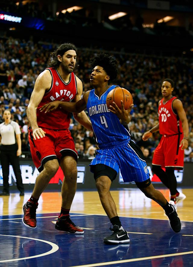 LONDON, ENGLAND - JANUARY 14: Elfrid Payton #4 of the Orlando Magic drives against Luis Scola #4 of the Toronto Raptors during the 2016 NBA Global Games London match between Toronto Raptors and Orlando Magic at The O2 Arena on January 14, 2016 in London, England. (Photo by Clive Rose/Getty Images)