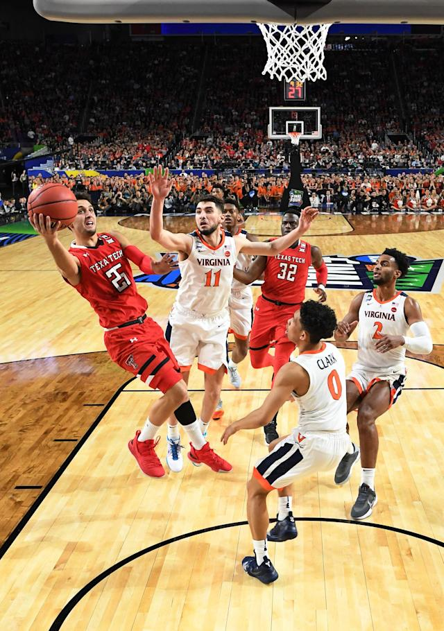Davide Moretti #25 of the Texas Tech Red Raiders drives to the basket against the Virginia Cavaliers during the second half of the 2019 NCAA men's Final Four National Championship game at U.S. Bank Stadium on April 08, 2019 in Minneapolis, Minnesota. (Photo by Brett Wilhelm/NCAA Photos via Getty Images)