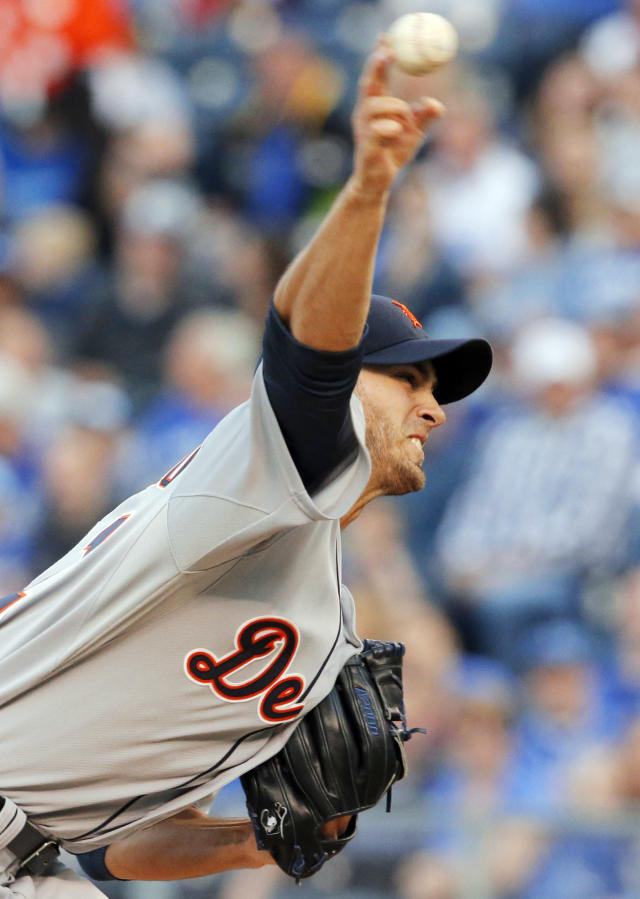 Detroit Tigers starting pitcher Rick Porcello delivers to a Kansas City Royals batter during the first inning of a baseball game in Kansas City, Mo., Friday, May 2, 2014. The Tigers won 8-2. Porchello picked up the win. (AP Photo/Orlin Wagner)