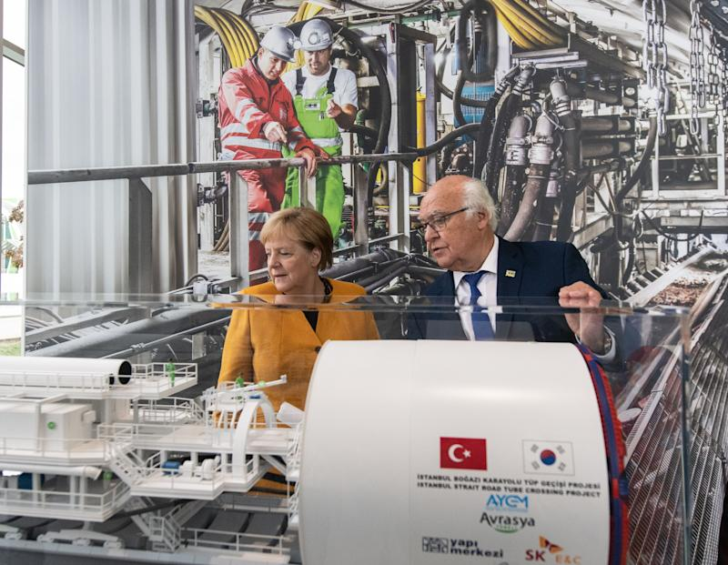 German Chancellor Angela Merkel stands next to company founder and CEO Martin Herrenknecht as she visits the Herrenknecht company producing tunnel boring machines and developing project-specific tunnelling technologies plant in Schwanau, southern Germany, on October 7, 2019. (Photo by Patrick Seeger / dpa / AFP) / Germany OUT (Photo by PATRICK SEEGER/dpa/AFP via Getty Images)