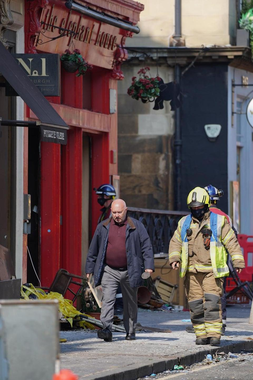 A man was seen removing items from the Elephant House cafe (Andrew Milligan/PA) (PA Wire)