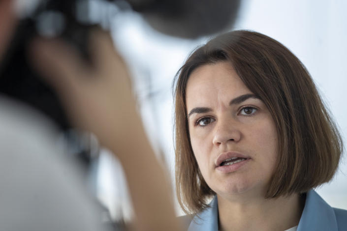 """Belarusian opposition leader Sviatlana Tsikhanouskaya, speaks during her interview with the Associated Press in Vilnius, Lithuania, Sunday, July 11, 2021. Tsikhanouskaya, the main opposition candidate in Belarus' presidential vote who was forced to flee to Lithuania after the election under authorities' pressure, shared that view. """"It's obviously an attempt of revenge by Lukashenko's regime to Lithuania and the whole European Union for their support of the civil society in Belarus,"""" she said. (AP Photo/Mindaugas Kulbis)"""