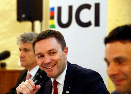 (L-R) Gabriele Fiono, Deputy Director of CEA Tech, Commissariat a l'energie atomique et aux energies alternatives (CEA), David Lappartient, President of the International Cycling Union (UCI), and Jean-Christophe Peraud, UCI Manager of Equipment and the Fight against technological fraud, attend a news conference on the fight against technological fraud in Geneva, Switzerland March 21, 2018. REUTERS/Denis Balibouse