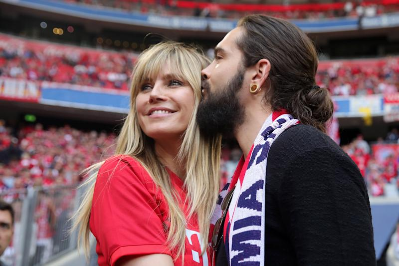 MUNICH, GERMANY - MAY 18: Heidi Klum poses for a photograph with boyfriend Tom Kaulitz prior to the Bundesliga match between FC Bayern Muenchen and Eintracht Frankfurt at Allianz Arena on May 18, 2019 in Munich, Germany. (Photo by Alexander Hassenstein/Bongarts/Getty Images)