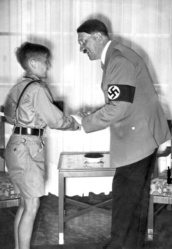 A picture dated 1936 shows German Chancellor and nazi dictator Adolf Hitler shaking hands with young Harald Quandt (1921-1967) in his uniform of the Hitlerian Youth Movement. Harald Quandt was Magda Goebbels' son from her first marriage with industrialist Günther Quandt. Magda and Joseph Goebbels committed suicide after murdering their six children in the Führerbunker in May 1945. Then prisoner of the Allied in Italy, Harald was the only one of Magda's children to survive. AFP PHOTO (Photo credit should read -/AFP/Getty Images)
