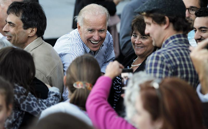 Vice President Joe Biden greets supporters on the steps of the State House in Concord, N.H., Friday, Sept. 21, 2012. (AP Photo/Cheryl Senter)
