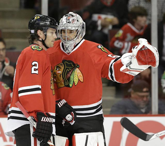 Chicago Blackhawks goalie Corey Crawford, right, talks with defenseman Duncan Keith (2) during the first period of an NHL hockey game against the Washington Capitals Tuesday, Oct. 1, 2013, in Chicago. (AP Photo/Nam Y. Huh)