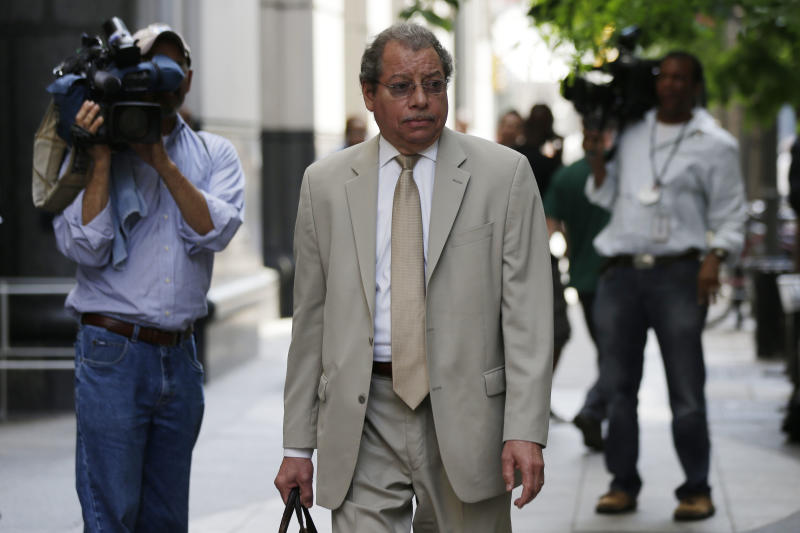Tom McGill, attorney for Adrienne Moton walks away from the center for criminal justice, Wednesday, May 29, 2013, in Philadelphia. Moton who pleaded pleaded guilty to third-degree murder and other charges stemming from her work at a corrupt, grimy Philadelphia abortion clinic is going home after being jailed for 28 months. (AP Photo/Matt Rourke)