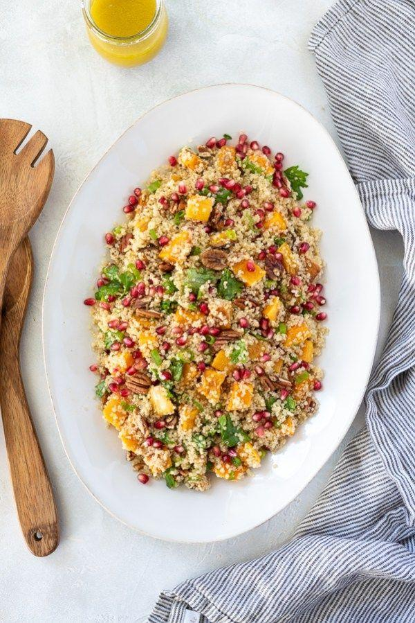 "<p>This side salad has almost every one of our favorite ingredients tossed together in one colorful bowl. Pecans? Check. Squash? Check. Pomegranate seeds? Check!</p><p><em><a href=""https://flavorthemoments.com/butternut-squash-quinoa-salad/"" rel=""nofollow noopener"" target=""_blank"" data-ylk=""slk:Get the recipe from Flavor the Moments »"" class=""link rapid-noclick-resp"">Get the recipe from Flavor the Moments »</a></em></p>"