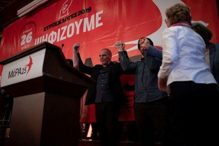 Leader of MeRA25 party and candidate for the European Parliament Yanis Varoufakis (C) raises his hands with the rest of the party's candidates following his speech during his pre-election campaign in Ioannina, Greece, May 16, 2019. Picture taken May 16, 2019. REUTERS/Alkis Konstantinidis