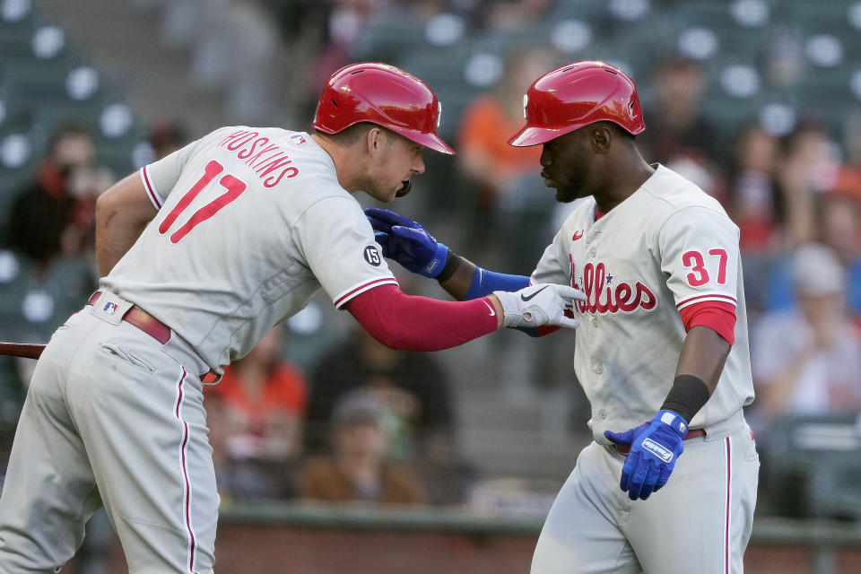 Philadelphia Phillies' Odubel Herrera (37) is congratulated by Rhys Hoskins (17) after hitting a solo home run against the San Francisco Giants during the first inning of a baseball game Friday, June 18, 2021, in San Francisco. (AP Photo/Tony Avelar)
