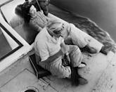 <p>Aristotle Onassis and Jackie relax on a boat while cruising down the Nile River. </p>