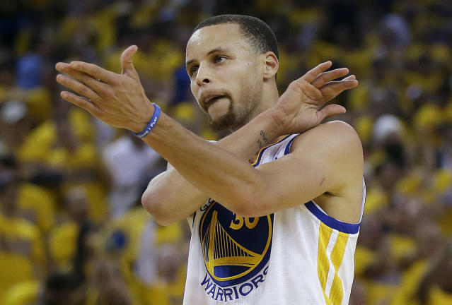 Golden State Warriors shooting guard Stephen Curry gestures against the Los Angeles Clippers during the first quarter of Game 6 of an opening-round NBA basketball playoff series in Oakland, Calif., Thursday, May 1, 2014. (AP Photo/Marcio Jose Sanchez)
