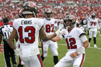 Tampa Bay Buccaneers quarterback Tom Brady (12) celebrates with wide receiver Mike Evans (13) after Evans caught a 3-yard touchdown pass during the first half of an NFL football game Sunday, Sept. 19, 2021, in Tampa, Fla. (AP Photo/Mark LoMoglio)