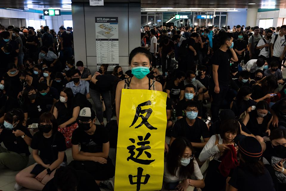 """HONG KONG, CHINA - AUGUST 21: Protestors gather during a protest at the Yuen Long MTR station on August 21, 2019 in Hong Kong, China. Pro-democracy protesters have continued rallies on the streets of Hong Kong against a controversial extradition bill since 9 June as the city plunged into crisis after waves of demonstrations and several violent clashes. Hong Kong's Chief Executive Carrie Lam apologized for introducing the bill and declared it """"dead"""", however protesters have continued to draw large crowds with demands for Lam's resignation and completely withdraw the bill. (Photo by Billy H.C. Kwok/Getty Images)"""