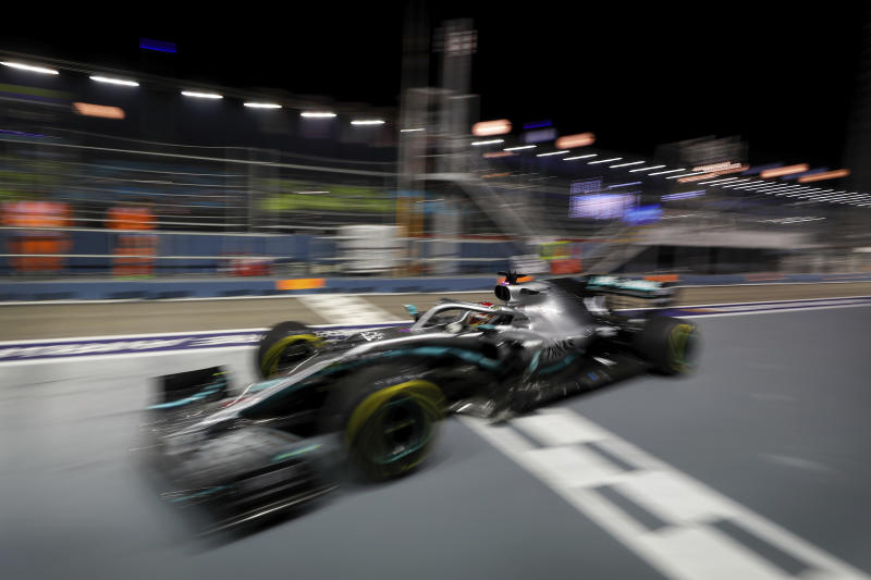 Mercedes driver Lewis Hamilton of Britain steers his car during the second practice session at the Marina Bay City Circuit ahead of the Singapore Formula One Grand Prix in Singapore, Friday, Sept. 20, 2019. (AP Photo/Vincent Thian)