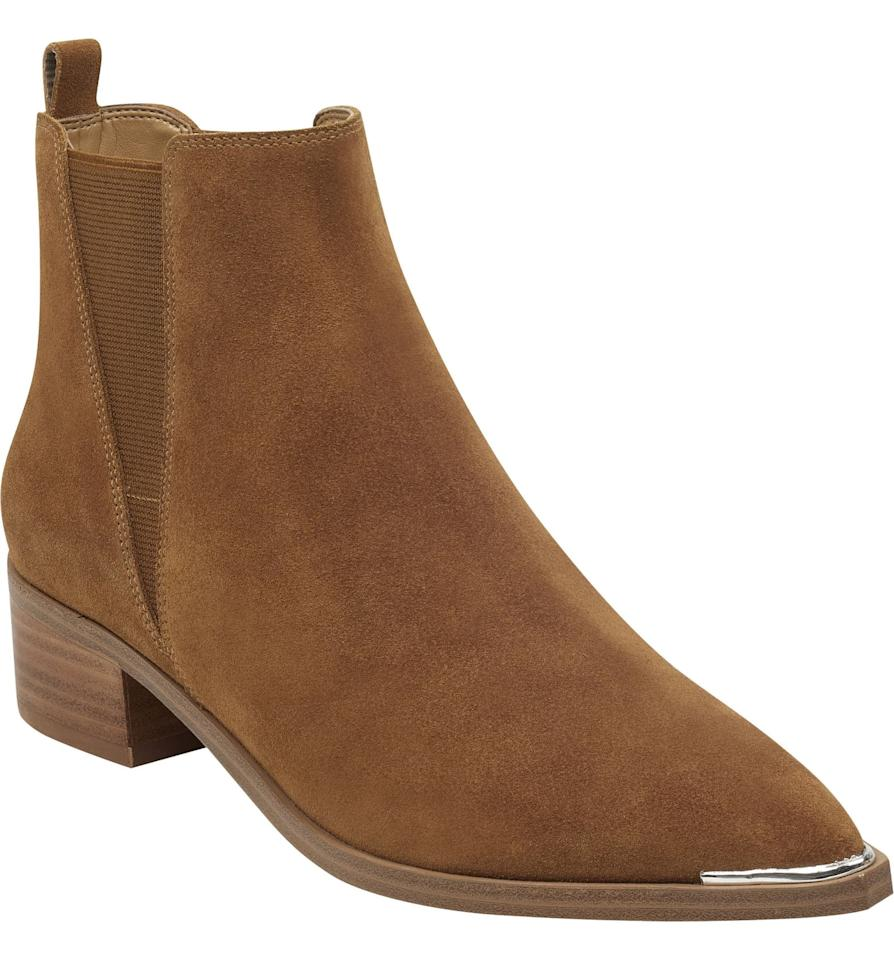 """<p>These <a href=""""https://www.popsugar.com/buy/Marc-Fisher-LTD-Yale-Chelsea-Boots-488822?p_name=Marc%20Fisher%20LTD%20Yale%20Chelsea%20Boots&retailer=shop.nordstrom.com&pid=488822&price=179&evar1=fab%3Aus&evar9=46594108&evar98=https%3A%2F%2Fwww.popsugar.com%2Ffashion%2Fphoto-gallery%2F46594108%2Fimage%2F46594128%2FMarc-Fisher-LTD-Yale-Chelsea-Boot&list1=shopping%2Cfall%20fashion%2Cshoes%2Cboots%2Cfall%2Cbooties%2Csuede%2Cfall%20shoes&prop13=mobile&pdata=1"""" rel=""""nofollow"""" data-shoppable-link=""""1"""" target=""""_blank"""" class=""""ga-track"""" data-ga-category=""""Related"""" data-ga-label=""""https://shop.nordstrom.com/s/marc-fisher-ltd-yale-chelsea-boot-women/4144181?origin=keywordsearch-personalizedsort&amp;breadcrumb=Home%2FAll%20Results&amp;color=rhum%20suede"""" data-ga-action=""""In-Line Links"""">Marc Fisher LTD Yale Chelsea Boots</a> ($179) go with everything, and we love the metal tip detail.</p>"""