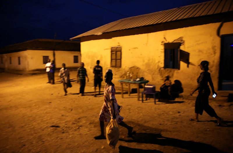 Locals walk on a street of Prestea, a mining town in southwest Ghana. (Photo: Siphiwe Sibeko/Reuters)