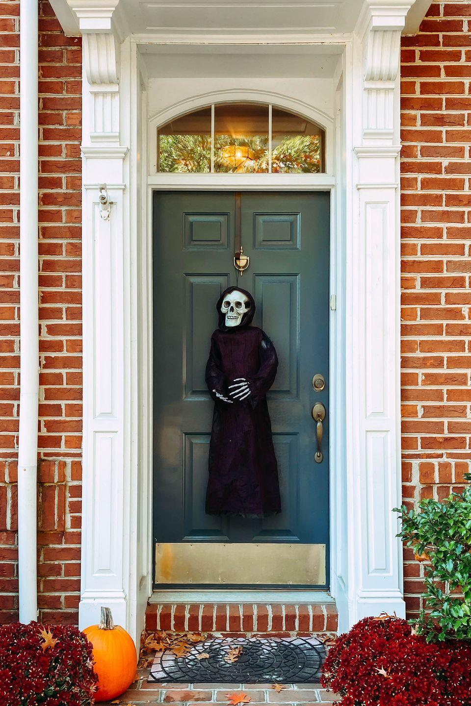"""<p>Place a cloaked skeleton at your door and see how many trick-or-treaters will dare to knock.<br><br><a class=""""link rapid-noclick-resp"""" href=""""https://go.redirectingat.com?id=74968X1596630&url=https%3A%2F%2Fwww.etsy.com%2Flisting%2F206702101%2Fhalloween-decor-cloaked-clay-skeleton-in&sref=https%3A%2F%2Fwww.goodhousekeeping.com%2Fholidays%2Fhalloween-ideas%2Fg32948621%2Fhalloween-door-decorations%2F"""" rel=""""nofollow noopener"""" target=""""_blank"""" data-ylk=""""slk:SHOP CLOAKED CLAY SKELETON"""">SHOP CLOAKED CLAY SKELETON</a></p>"""