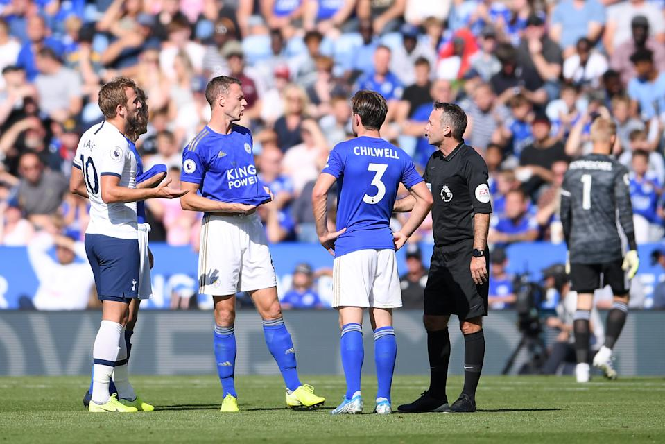 LEICESTER, ENGLAND - SEPTEMBER 21:  Referee Paul Tierney and Jonny Evans of Leicester City in discussion as they wait for a VAR decision during the Premier League match between Leicester City and Tottenham Hotspur at The King Power Stadium on September 21, 2019 in Leicester, United Kingdom. (Photo by Laurence Griffiths/Getty Images)