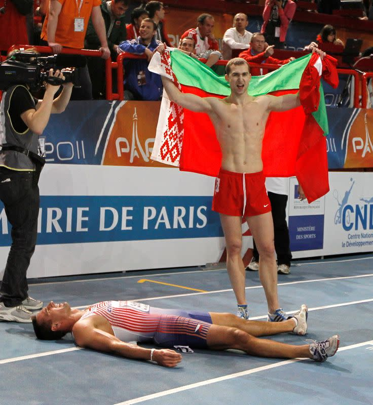 FILE PHOTO: Belarus's Krauchanka and Czech Republic's Sebrle react after the men's Heptathlon event at the European Athletics indoor championships in Paris