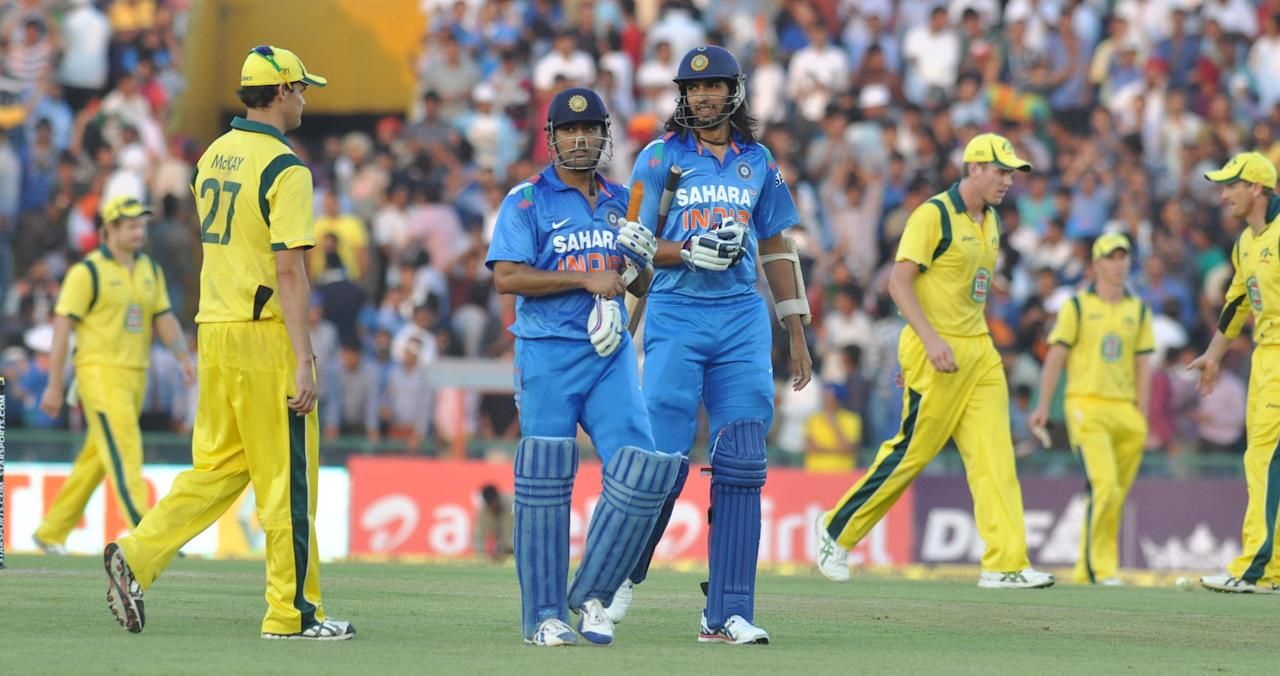 M S Dhoni and Isahant Sharma during the 3rd ODI between India and Australia at  Punjab Cricket Association Stadium, Mohali, Chandigarhon Oct. 19, 2013. (Photo: IANS)