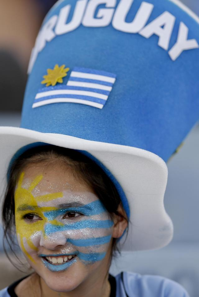 A fan of Uruguay waits for the start of a 2014 World Cup qualifying soccer match against Colombia in Montevideo, Uruguay, Tuesday, Sept. 10, 2013. (AP Photo/Natacha Pisarenko)