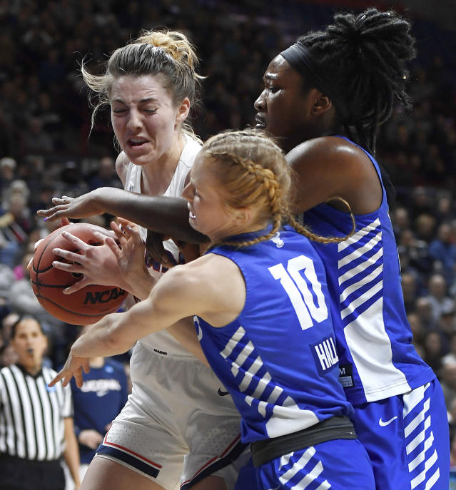 Buffalo's Hanna Hall, front, and Adebola Adeyeye, right, pressure Connecticut's Katie Lou Samuelson during the second half of a second-round women's college basketball game in the NCAA tournament, Sunday, March 24, 2019, in Storrs, Conn. (AP Photo/Jessica Hill)