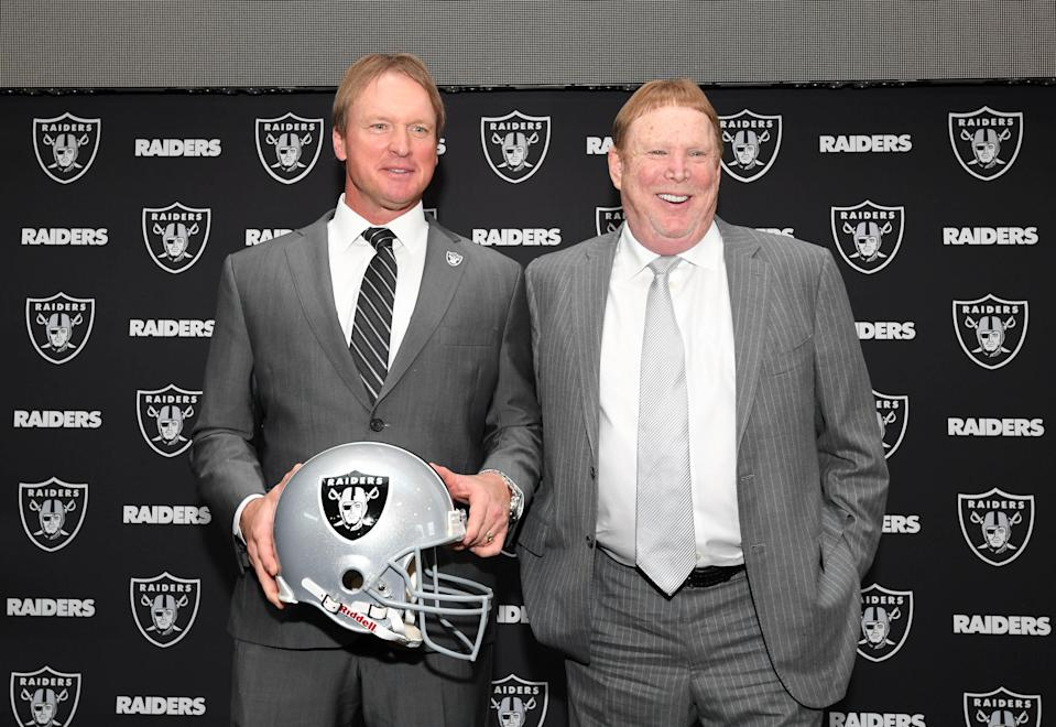 Jon Gruden (L) poses with Raiders owner Mark Davis (R) after being introduced as head coach at a press conference at the Raiders headquarters.