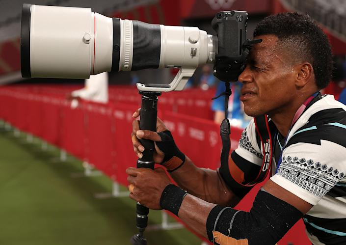 <p>Napolioni Bolaca of Fiji goes for the camera after his team wins the rugby sevens men's gold medal match against New Zealand on July 28.</p>