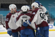 Colorado Avalanche right wing Mikko Rantanen, right, is congratulated by teammates after scoring a goal against the San Jose Sharks during the second period of an NHL hockey game in San Jose, Calif., Wednesday, March 3, 2021. (AP Photo/Jeff Chiu)