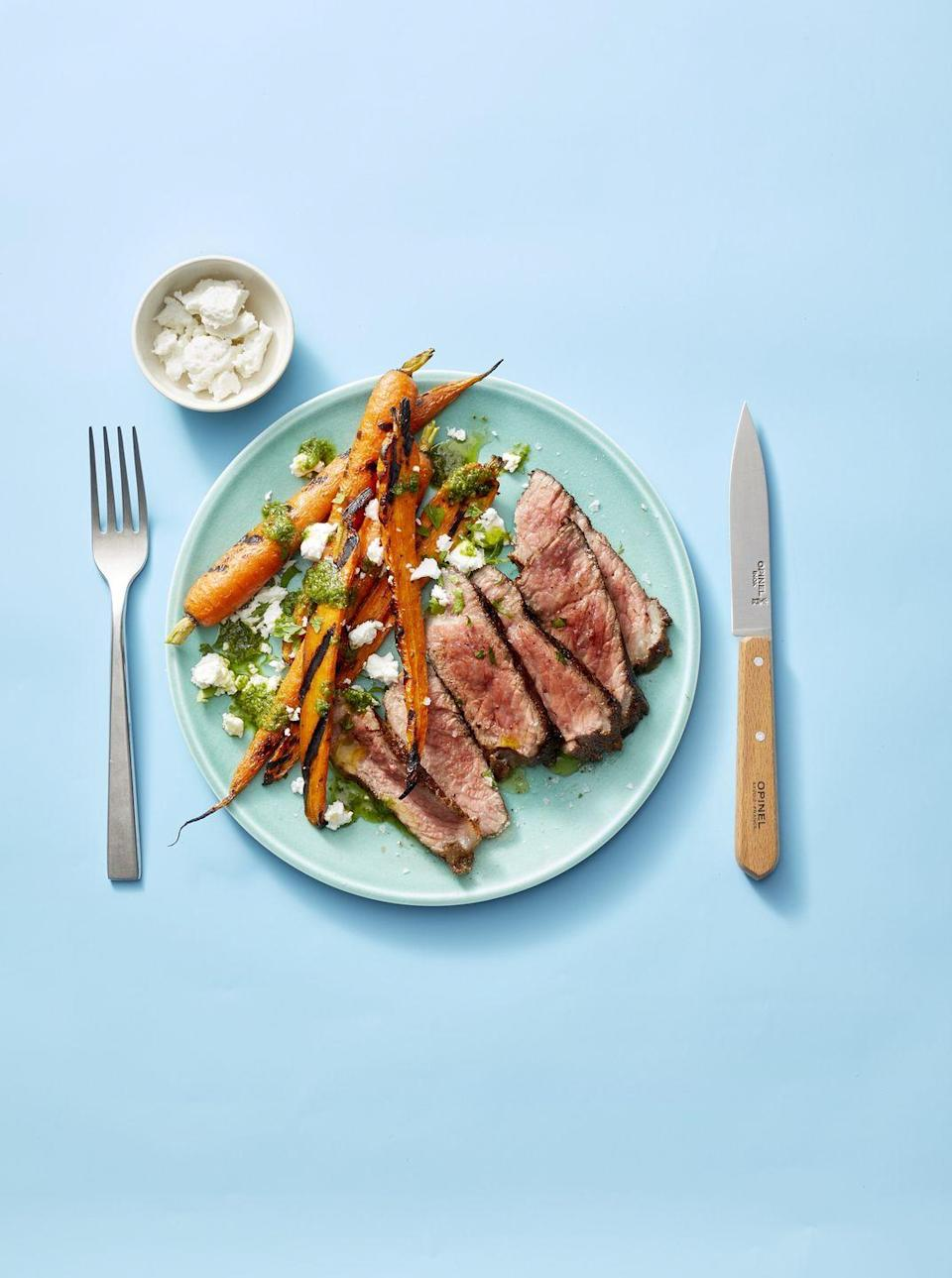 """<p>Rather than a bottled marinade, you'll use a few aromatic spices to dress these steaks up a few days beforehand. It'll burst with flavor alongside seasonal veggies.</p><p><em><a href=""""https://www.goodhousekeeping.com/food-recipes/easy/a28470209/grilled-moroccan-steak-and-carrots-recipe/"""" rel=""""nofollow noopener"""" target=""""_blank"""" data-ylk=""""slk:Get the recipe for Grilled Moroccan Steak and Carrots »"""" class=""""link rapid-noclick-resp"""">Get the recipe for Grilled Moroccan Steak and Carrots »</a></em></p>"""
