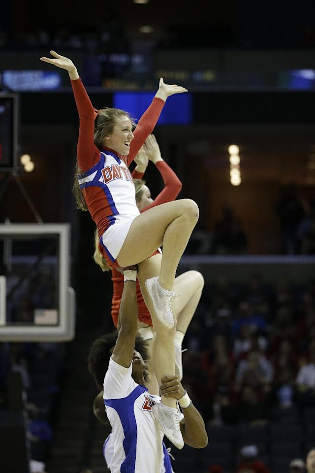 Dayton cheerleaders perform against Stanford during the first half in a regional semifinal game at the NCAA college basketball tournament, Thursday, March 27, 2014, in Memphis, Tenn. (AP Photo/Mark Humphrey)