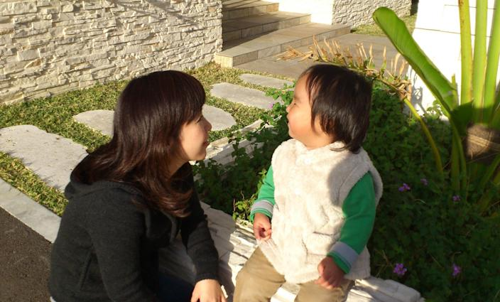 """In this photo released by Minaho Kubota, Kubota chats with her two-year-old son in Naha, Okinawa, Japan. Okinawa is about as far away as one can get from Fukushima without leaving Japan, and that is why Kubota is here. Petrified of the radiation spewing from the Fukushima Dai-ichi nuclear plant that went into multiple meltdowns last year, Kubota grabbed her children, left her skeptical husband and moved to the small southwestern island. More than a thousand people from the disaster zone have done the same thing. """"I thought I would lose my mind,"""" Kubota told The Associated Press in a recent interview. """"I felt I would have no answer for my children if, after they grew up, they ever asked me, """"Mama, why didn't you leave?"""" (AP Photo/Courtesy of Minaho Kubota)"""