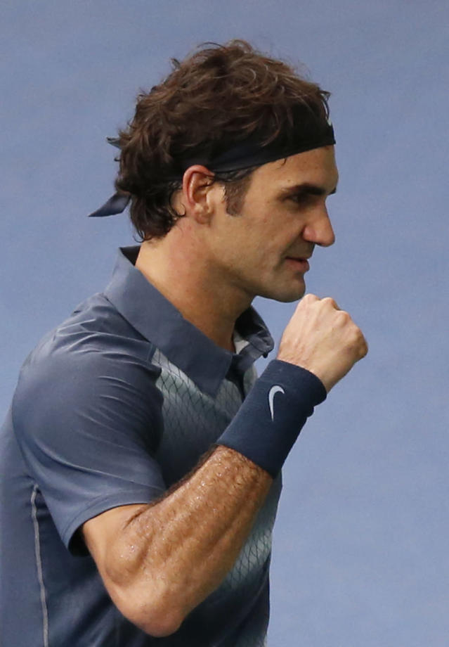 Roger Federer of Switzerland reacts on the match point against Juan Martin Del Potro of Argentina during their quarterfinal match, at the Paris Masters tennis at Bercy Arena in Paris, France, Friday, Nov.1, 2013. (AP Photo/Francois Mori)