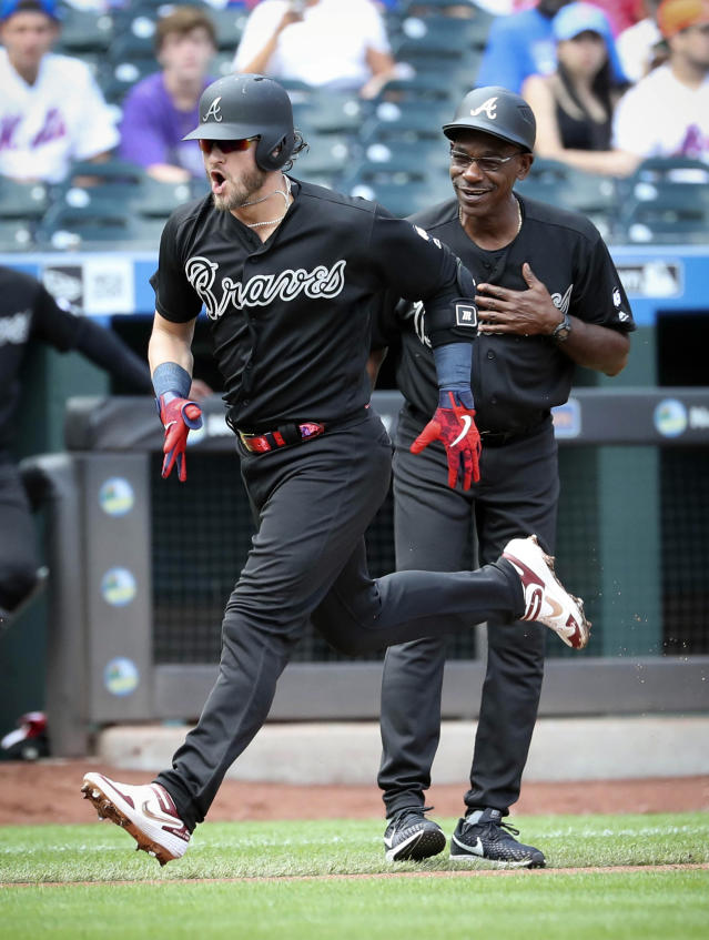 Atlanta Braves third base coach Ron Washington, right, cheers Josh Donaldson who runs the bases after a home run during a baseball game against the New York Mets, Sunday Aug. 25, 2019, in New York. (AP Photo/Bebeto Matthews)