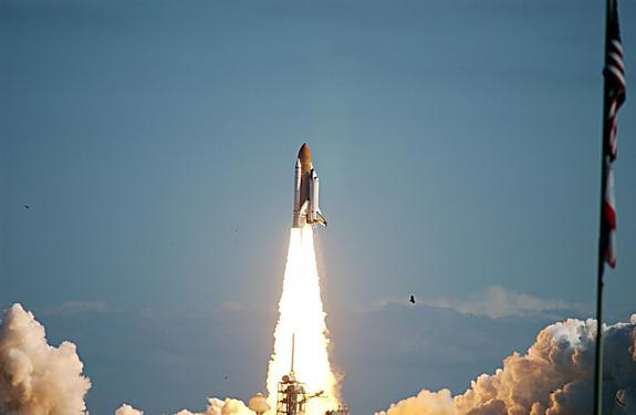 Space Shuttle Columbia hurtles through a perfect blue Florida sky following. Liftoff of Columbia on mission STS-107 occurred on-time at 10:39 a.m. EST on Jan. 16, 2003.