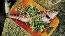 "Learn how to cook a whole fish and you'll have summer's most impressive dinner in your back pocket. Two tips for grilling whole fish like a pro: Use two large metal spatulas to make turning it a lot easier, and season the entire fish—we're talking head to tail and inside and out. <a href=""https://www.bonappetit.com/recipe/grilled-salt-and-pepper-black-bass-with-curry-verde?mbid=synd_yahoo_rss"" rel=""nofollow noopener"" target=""_blank"" data-ylk=""slk:See recipe."" class=""link rapid-noclick-resp"">See recipe.</a>"