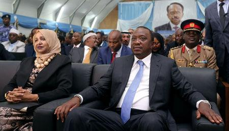 Kenya's President Uhuru Kenyatta sits next to Somalia's first lady Zeinab Abdi as they attend the inauguration ceremony of Somalia's newly elected President Mohamed Abdullahi Farmaajo in Somalia's capital Mogadishu